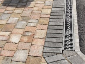 Aco channel with 3 size multi-block paving. The Aco channel leads to a new soakaway.
